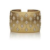 a gold and diamond cuff bracelet by buccellati
