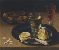 still life of lemons, chestnuts and a wine glass by osias beert the elder