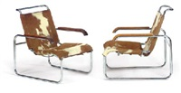 a pair of chromed tubular steel and cowhide armchairs, model no. b35, designed 1928 by marcel breuer