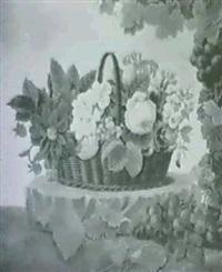 kurv med roser, georginer og forglemmigej pa en sten    omgivet af drueklaser by hanne elise jacobsen