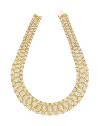 gold and diamond necklace by buccellati
