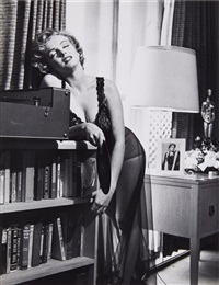 marilyn listening to music by philippe halsman