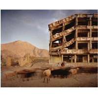 afghanistan - bullet scarred apartment building and shops in the karte char of kabul by simon norfolk