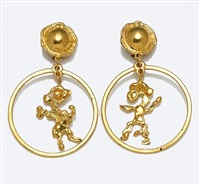 a pair of earrings of openwork happy monster motif by jean mahie