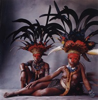 two new guinea young women with feathers by irving penn
