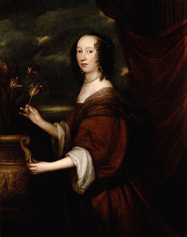 portrait of lady ingleby standing beside an urn of tulips wearing a brown dress and a pearl necklace by john hayls