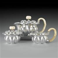 a silver tea service, consisting of: teapot, sugar bowl, milk jug by josef hoffmann