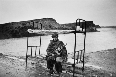a member of the hezbi-islami guarding the road to kabul, afghanistan by abbas