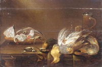 still life with a bowl of fish, a glass, a flagon, a partridge, a kingfisher, a blue tit and other songbirds on a wooden table by alexander adriaenssen