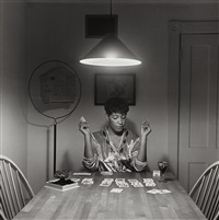 untitled (woman playing solitaire) from the kitchen table by carrie mae weems