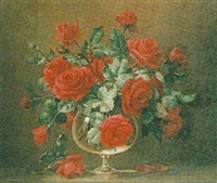 still life of red roses in a pedestal glass vase by bernard allfree