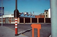 factory on street corner, belgique by harry gruyaert