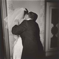 groom kissing his bride, n.y.c by diane arbus