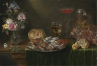 a still life with a platter of crabs and shrimp, a glass jug of flowers, a roemer and a long-stemmed tazza of wine, an earthenware jug, a loaf of bread, a bunch of grapes and a half-peeled lemon by alexander adriaenssen