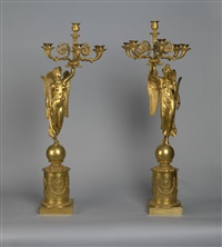 a pair of candelabras with figures of fame by pierre philippe thomire