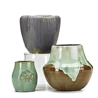 bulbous vase in frothy green over sienna brown, vase in violet with molded reeding, and cabinet vase in seafoam blossoms (3 works) by arequipa pottery