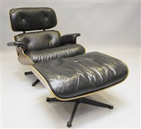 lounge chair mit ottomane by charles eames