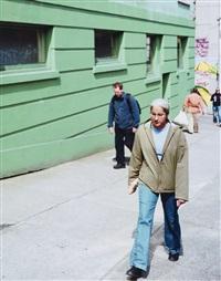 figures on a sidewalk by jeff wall