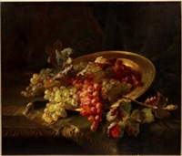 still life of grapes on a gilt brass charger with a rug on a table by pierre garnier