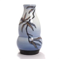 a b&g porcelain vase/table lamp decorated with branches and flowers by effie hegermann-lindencrone