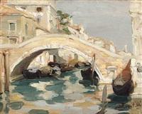 venezia. kanalansicht mit steinerner bogenbrücke an der piazza san giovanni e paolo im sonnigen licht by armando locatelli