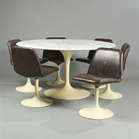 a circular table and six swivel chairs (set of 7) by eero saarinen