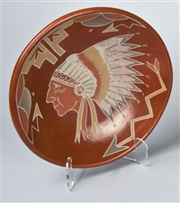 red plate with indian head by belen tapia