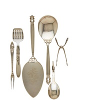 assembled serving pieces: acorn cake server. acorn serving spoon, cactus tomato server, blossom sugar tongs, fuchsia olive fork, and #21 jam spoon (6 works) by georg jensen (co.)