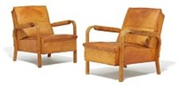a pair of rare and early easy chairs with moulded birch frames, armrests wrapped in leather cord by alvar aalto