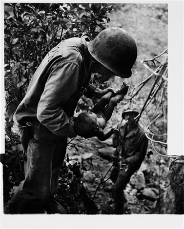 wounded dying infant found by american soldier in saipan mountains by w eugene smith