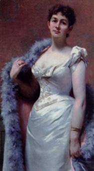 ung dame i en cremefarvet selskabskjole by amélie valentino