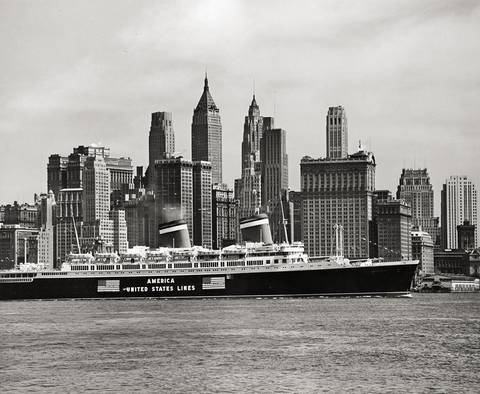 s.s. america and the skyscrapers of downtown manhattan, new york city by andreas feininger