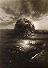 untitled (rock mound on beach) by jerry uelsmann