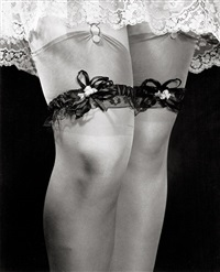 woman's legs with garters by philippe halsman