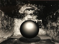 untitled (floating sphere in eye room) by jerry uelsmann