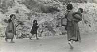 spanish women and children fleeing by robert capa