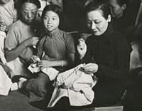 madame chiang kai-shek with refugees by robert capa