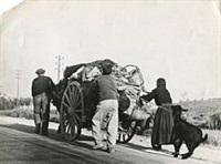 families fleeing in carts by robert capa