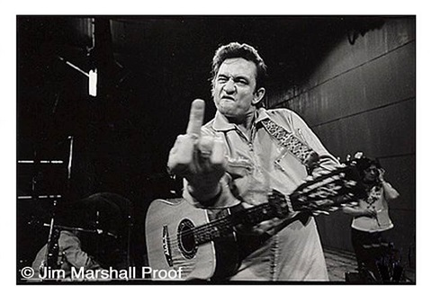 johnny cash (flipping the bird), san quentin prison, 1969 by jim marshall