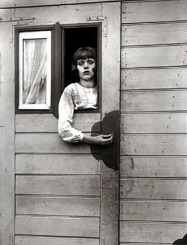 girl in a circus caravan by august sander