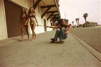 sidewalk surfer, the promenade, huntington beach by hugh holland