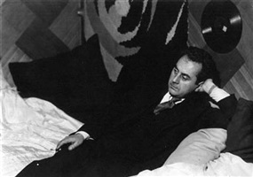 self portrait with record, lying down by man ray