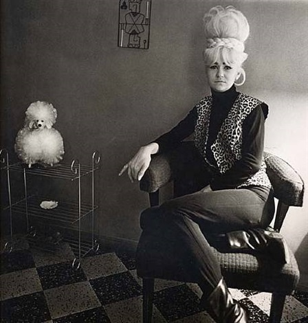 lady bartender at home with a souvenir dog, new orleans by diane arbus