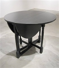 a sculpture of a black gateleg table, both open and closed by roy mcmakin