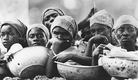 haitian women waiting for food supplies by eddie adams