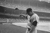 mickey mantle having a bad day at yankee stadium, new york, 1965 by john dominis