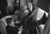john lennon on the train from new york to washington, dc, february, 1964 by bill eppridge