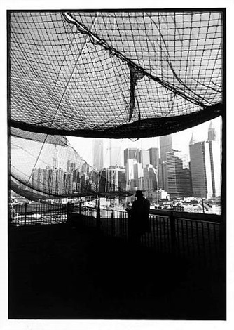 man reading on brooklyn bridge by burhan cahit dogançay