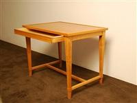 table en sycomore présentant un tiroir en ceinture, à pieds tronconiques et traverse. by jean-michel frank