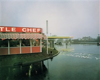little chef in rain st neots, cambridgeshire, may 1982, from the series a1 - the great north road by paul graham